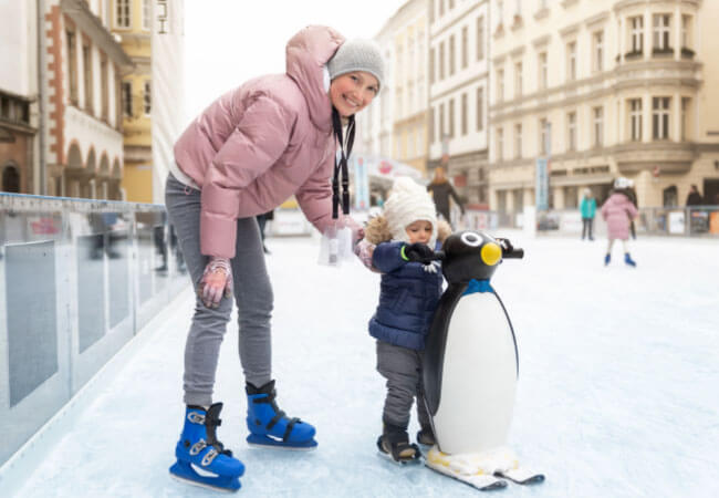 mother and son ice skating
